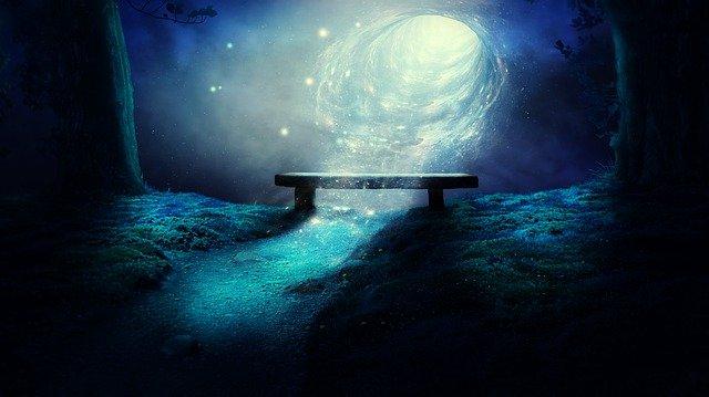 暗闇で光に照らされるベンチ