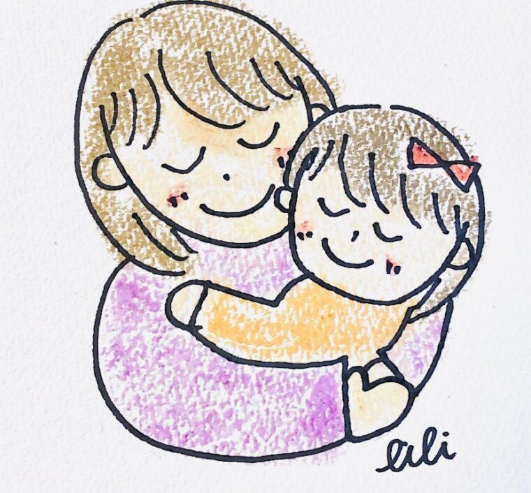 子どもを抱きしめる女性