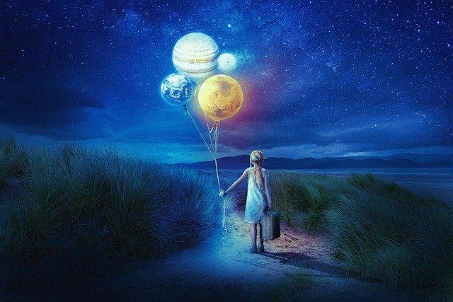 惑星の風船を持つ少女